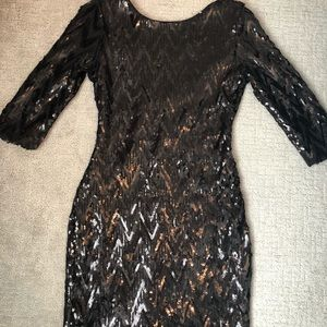 Dresses & Skirts - Small black sequin dress with low cut back